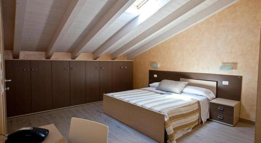 A bed or beds in a room at Affittacamere Borgo Roma