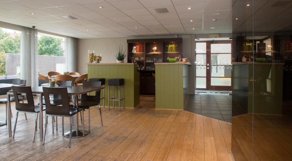 Restaurant ou autre lieu de restauration dans l'établissement Hotel Maxim