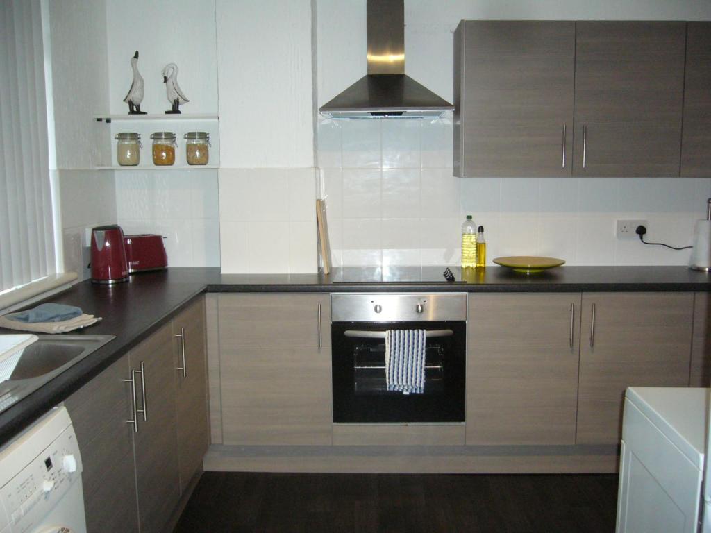 Dapur atau dapur kecil di Dragon - Attlee Apartment 3 Bedroom Home