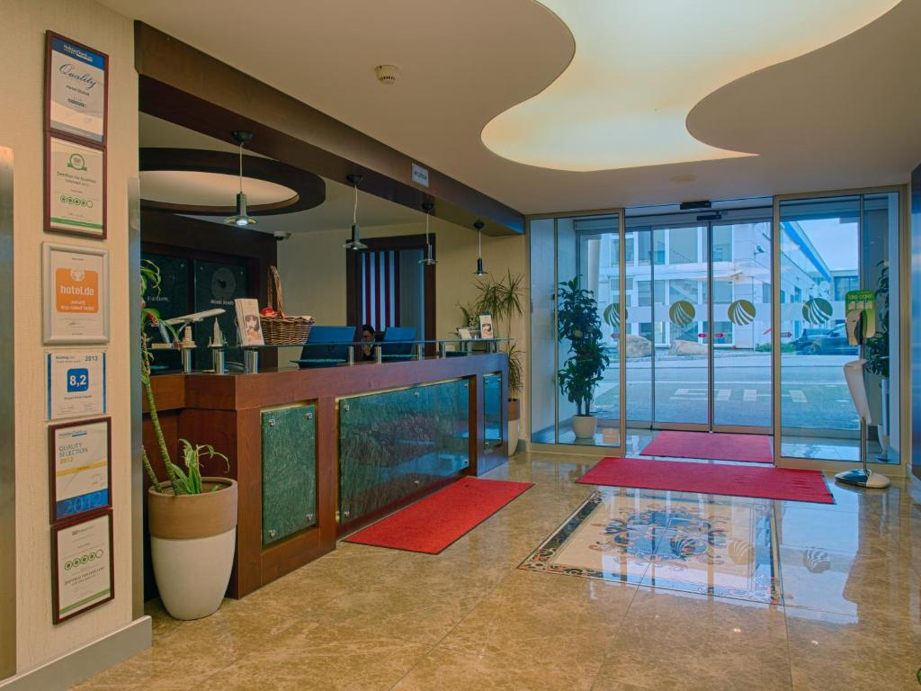 The lobby or reception area at Airport Global Hotel