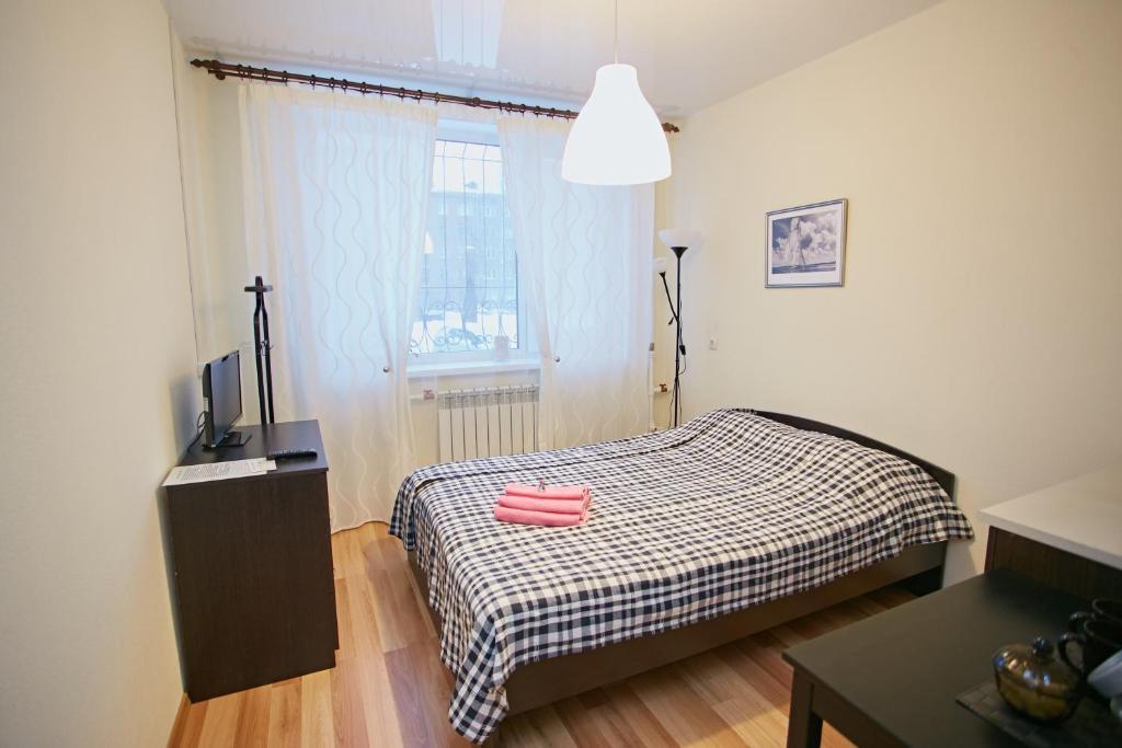 Кровать или кровати в номере Зона сна мини отель на Маркса