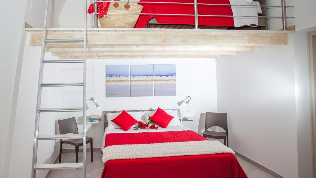 A bed or beds in a room at Primo Piano Settembrini Locazione Turistica