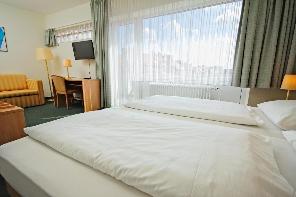 Ein Bett oder Betten in einem Zimmer der Unterkunft Hotel Wiking