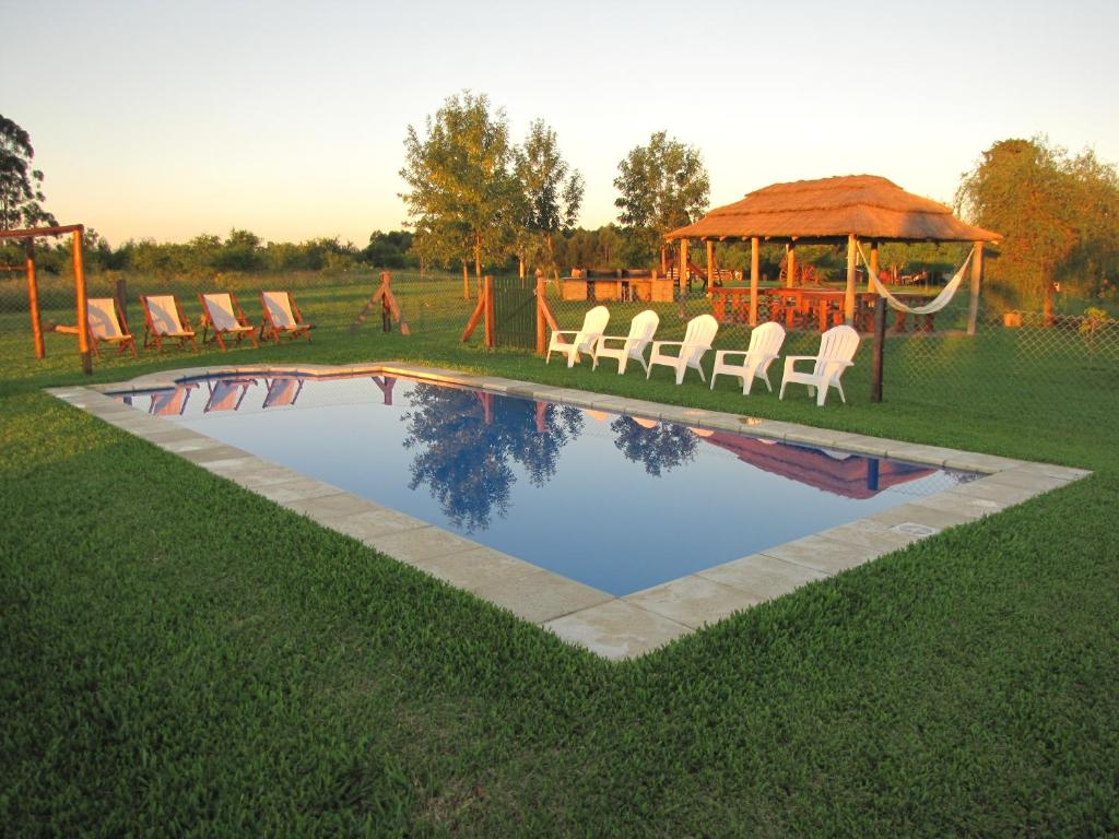 The swimming pool at or near La Trinidad Casa de Campo
