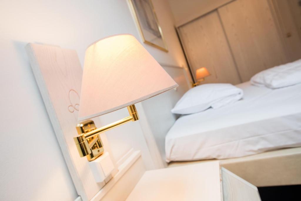 Ein Bett oder Betten in einem Zimmer der Unterkunft Aparthotel Wettenberg