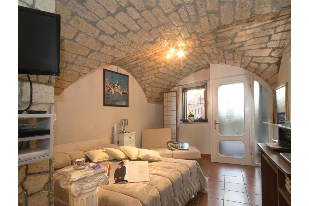 A bed or beds in a room at Monolocale Il Nido