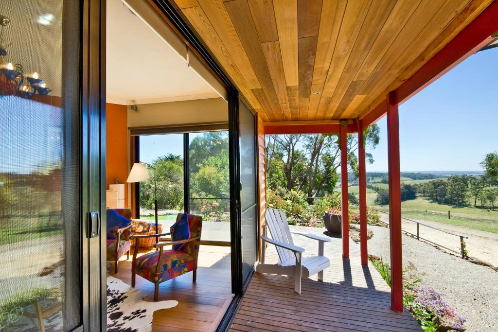 A balcony or terrace at Otway Escapes Luxury Spa Cottage Accommodation Victoria