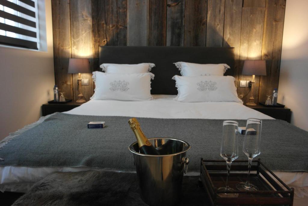 Een bed of bedden in een kamer bij B&B Sixteen