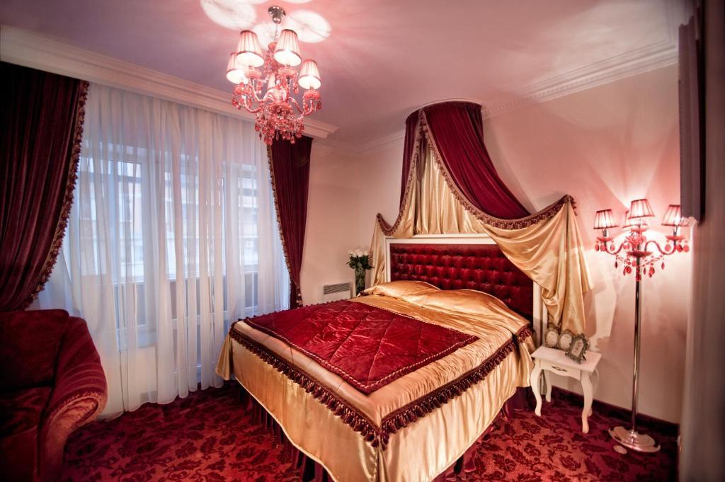 Lova arba lovos apgyvendinimo įstaigoje Royal City Hotel