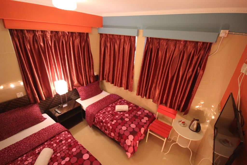 A bed or beds in a room at Comfort Hostel