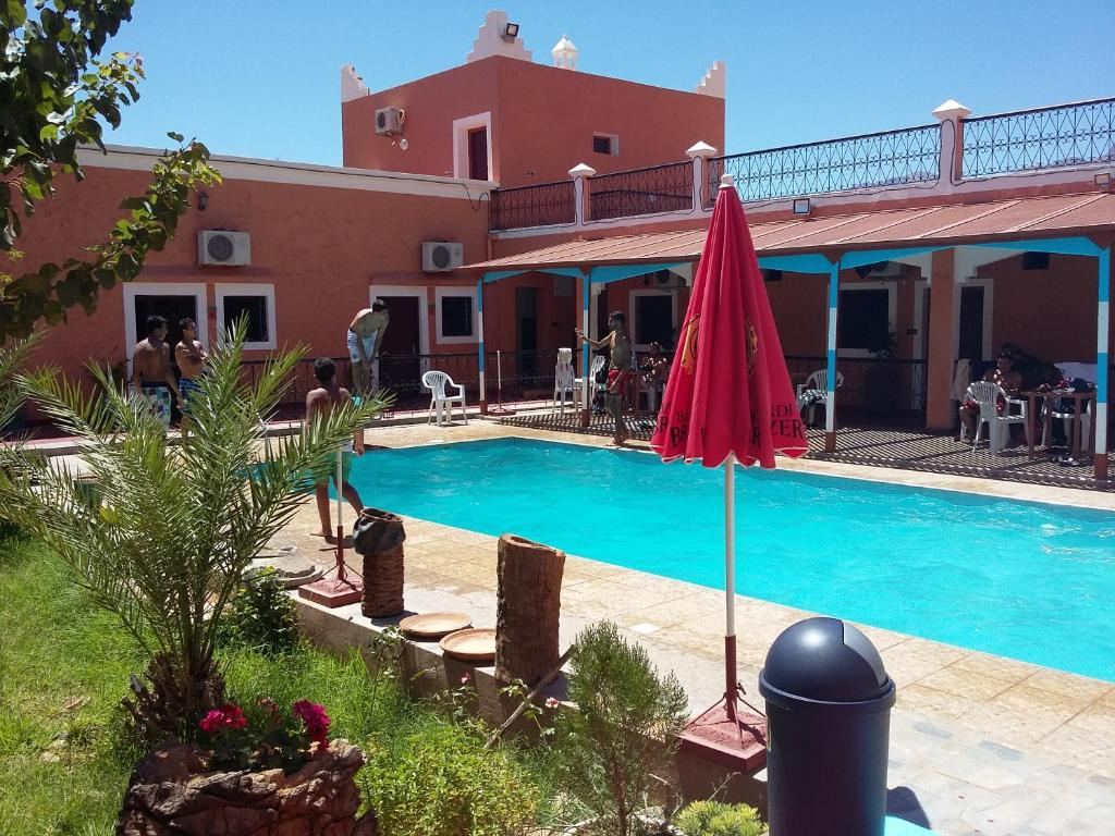The swimming pool at or near Hotel L'Arganier d'Ammelne