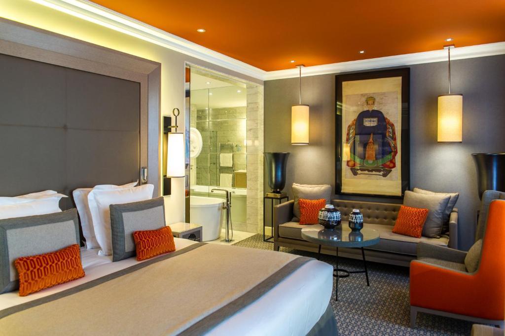 Un ou plusieurs lits dans un hébergement de l'établissement Hôtel Alchimy