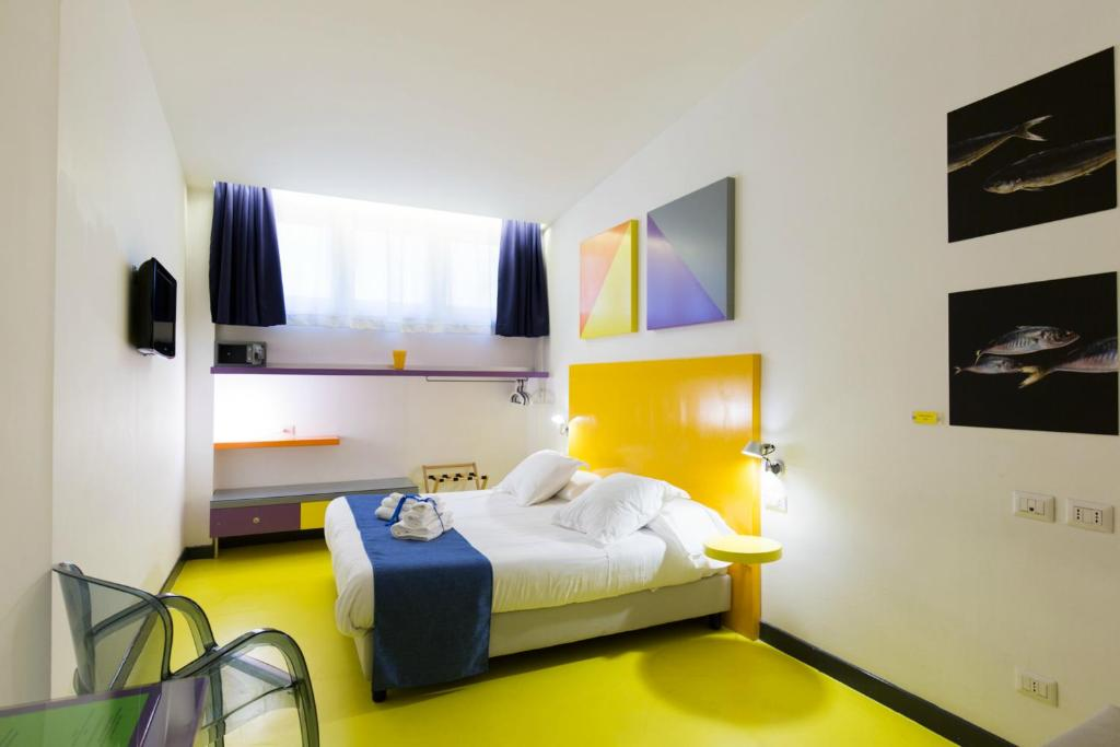 A bed or beds in a room at Correra 241 Lifestyle Hotel