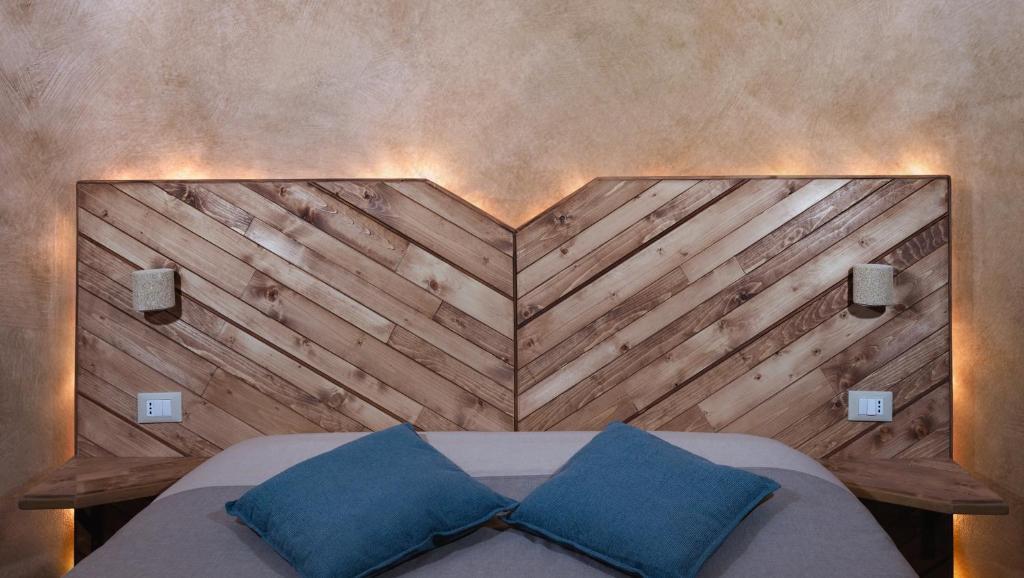Un ou plusieurs lits dans un hébergement de l'établissement Folia B&B