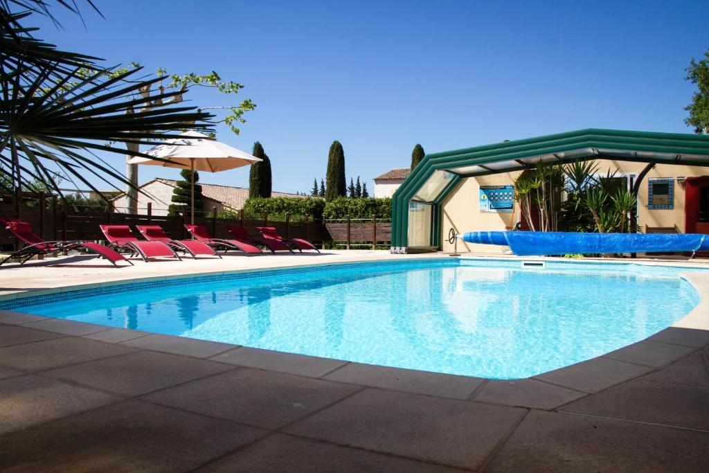 The swimming pool at or near Residence Melody