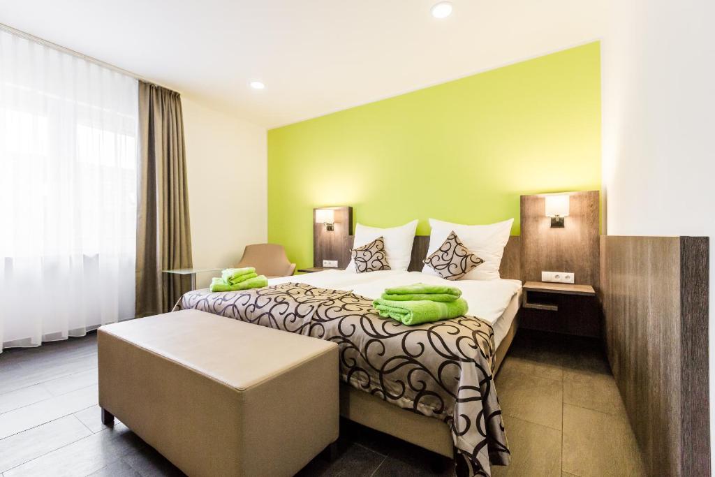 Кровать или кровати в номере Apartments Pulheim