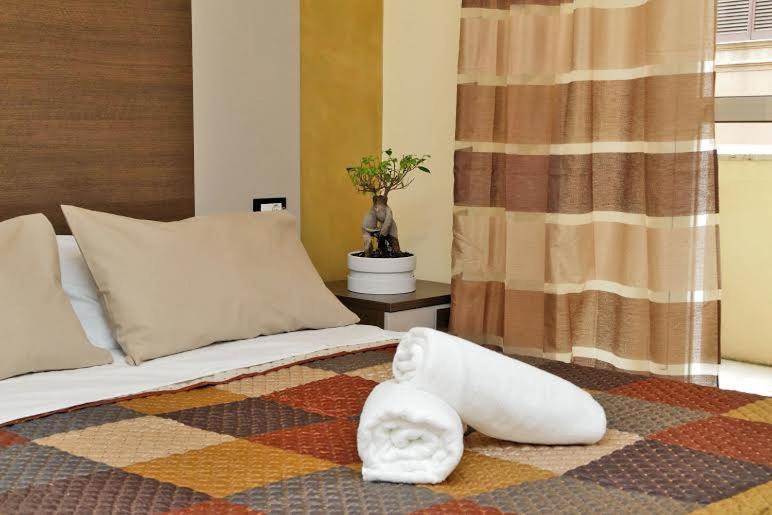 Cama ou camas em um quarto em Roma Suite Centro
