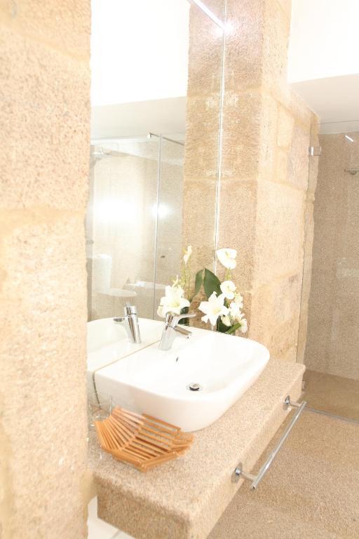Um banheiro em Solar Do Castelo