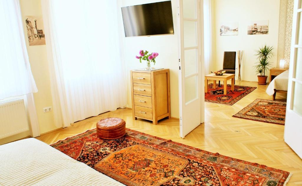 A television and/or entertainment center at SuperCentral Apartment