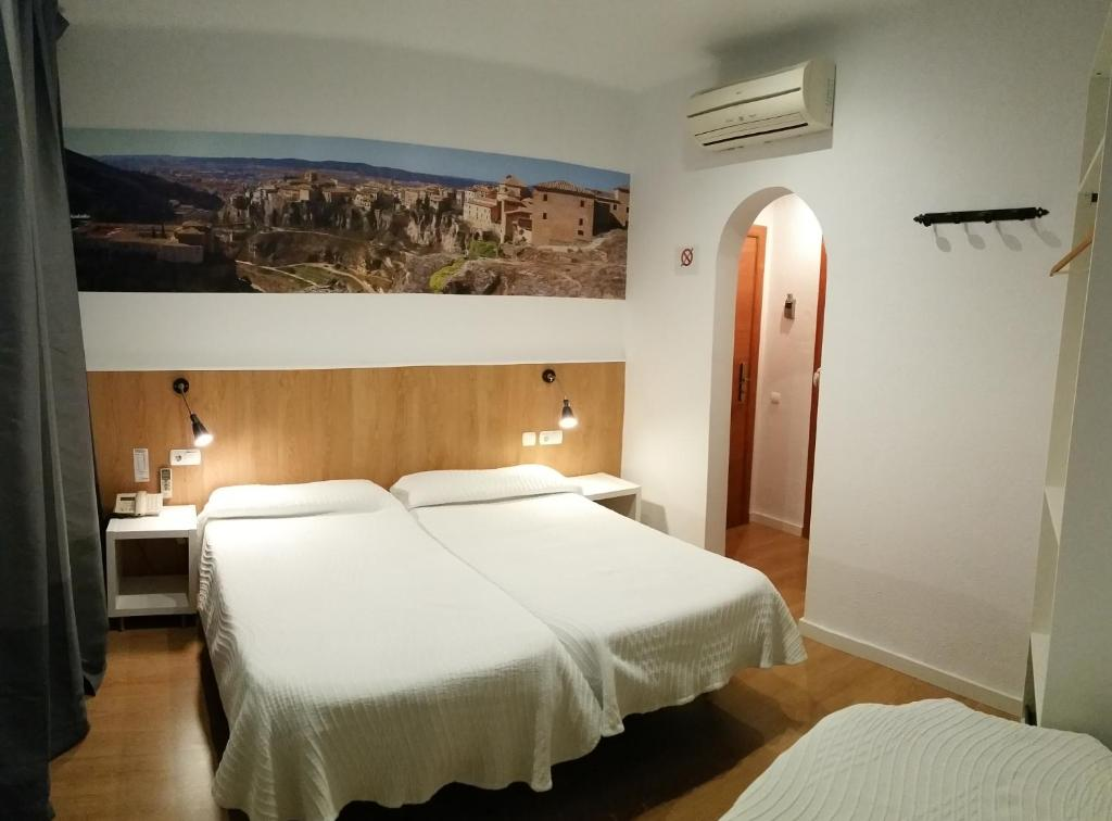 A bed or beds in a room at Hostal Restaurante Cornella