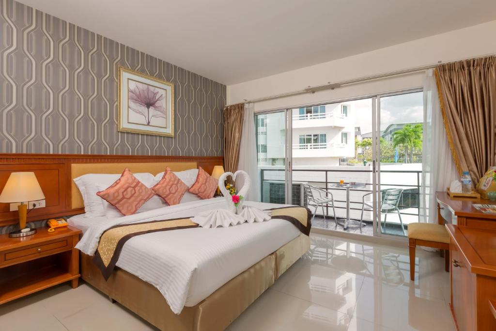 A bed or beds in a room at The Golden Ville Boutique Hotel and Spa