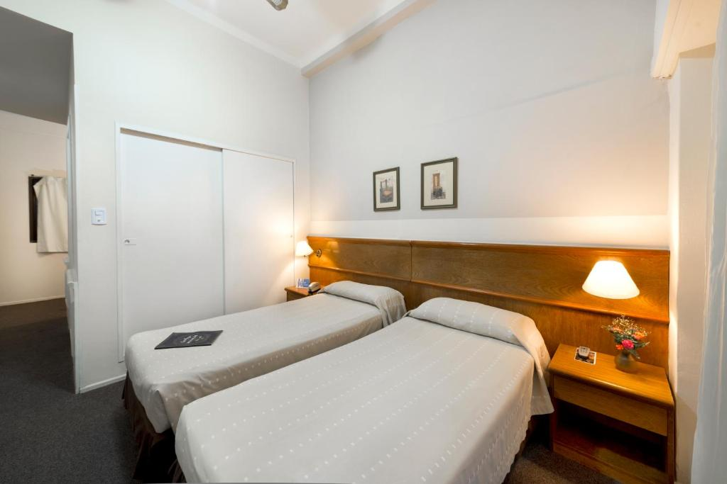 Cama o camas de una habitación en Catalinas Suites