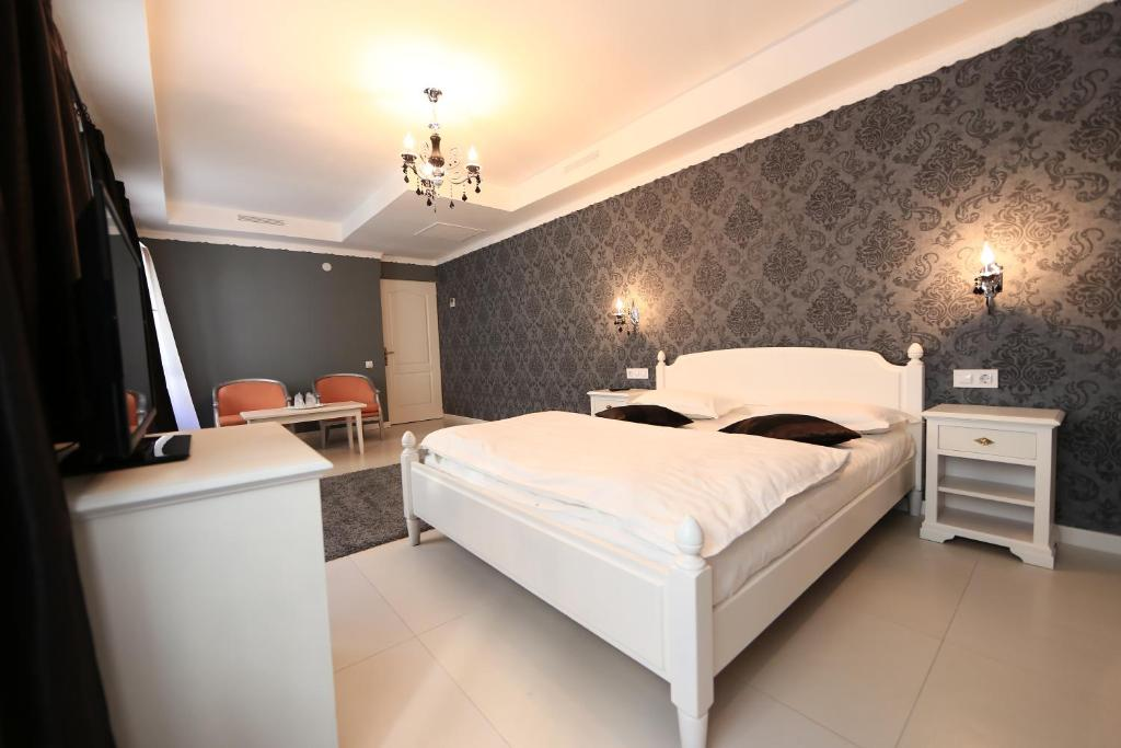 A bed or beds in a room at Old City Bucharest NF Hotels