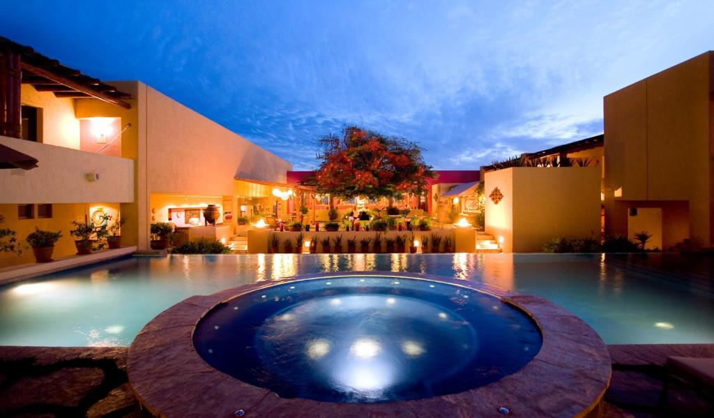 The swimming pool at or near Hotel Los Patios