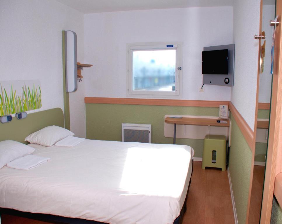 Un ou plusieurs lits dans un hébergement de l'établissement ibis budget Flers Grands Champs