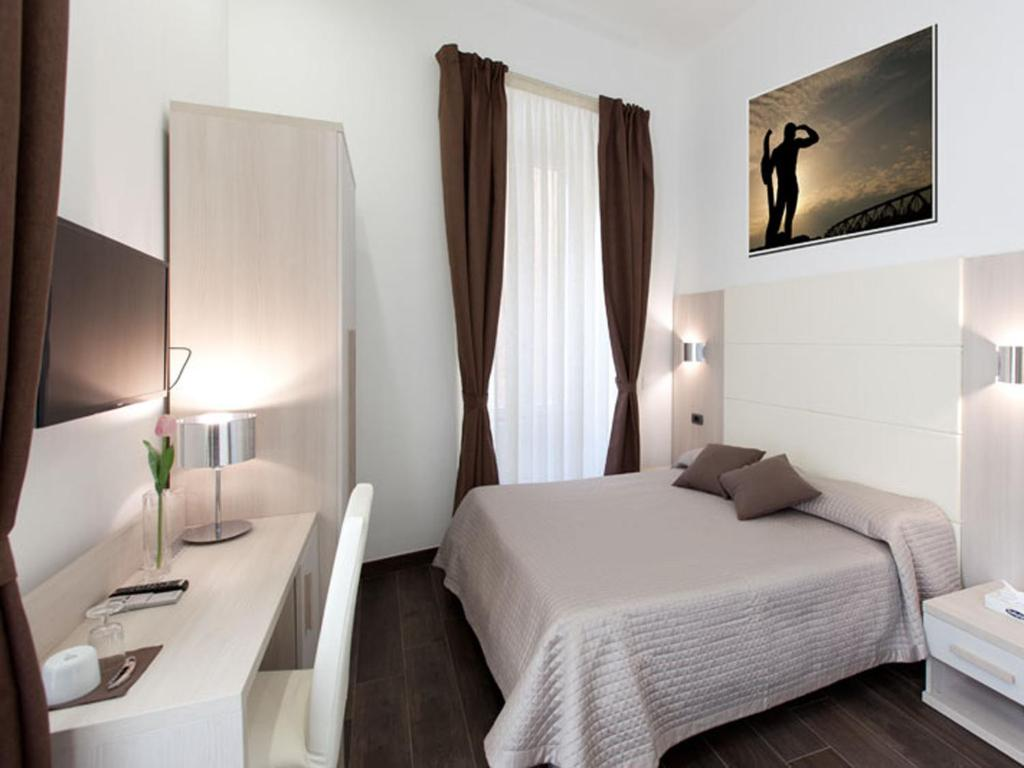 A bed or beds in a room at Campo dè Fiori Suites