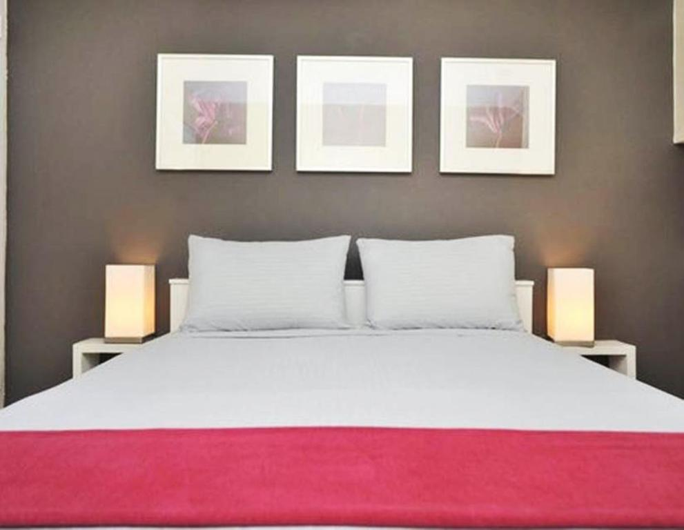A bed or beds in a room at #1Midtown Manhattan Loft Apartment