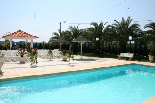 The swimming pool at or near Residencial Joao Capela