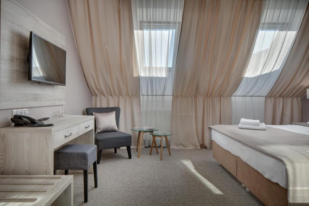 A bed or beds in a room at Hotel Florenc