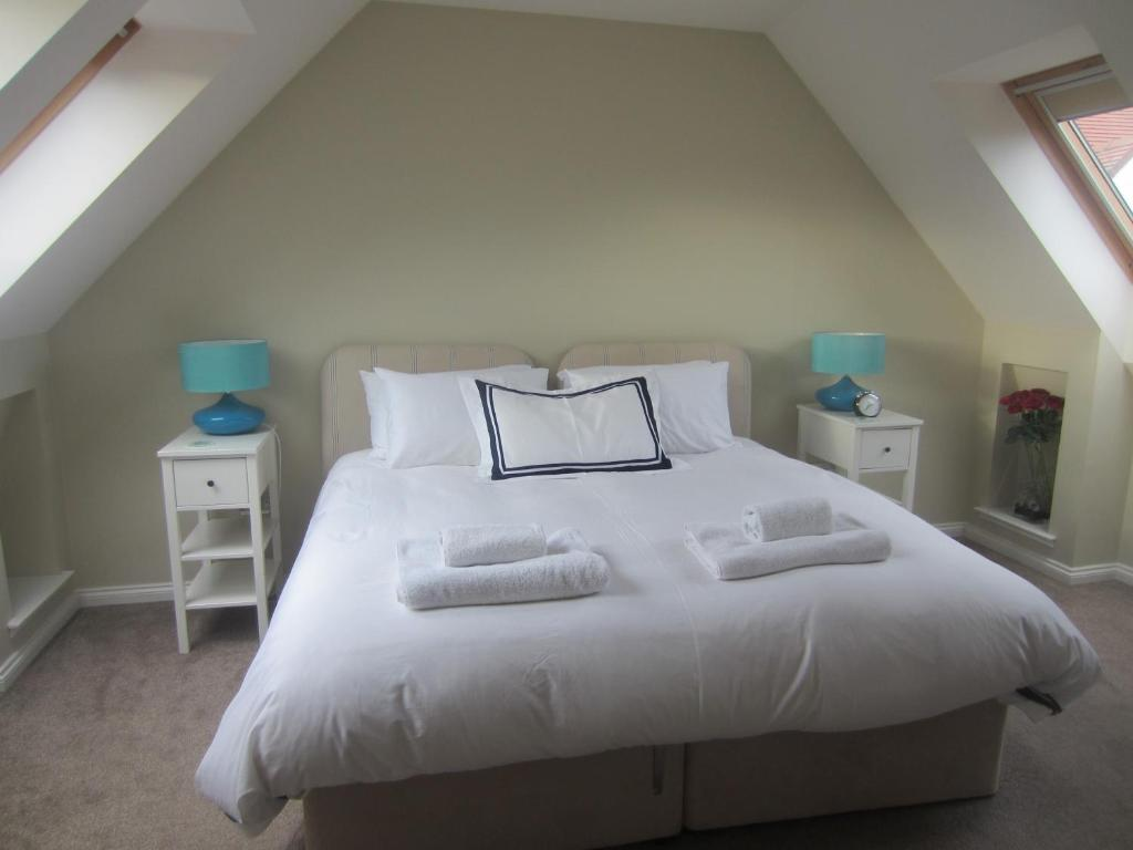A bed or beds in a room at St Leonards Lodge