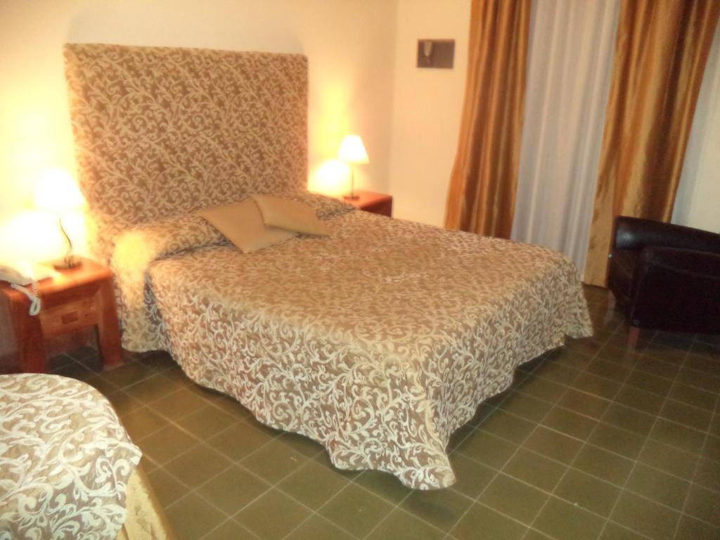 Letto o letti in una camera di Hotel Scala Greca