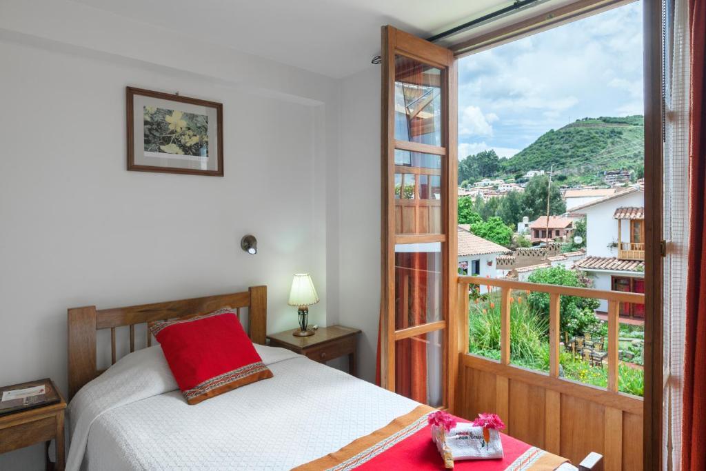 Cama o camas de una habitación en B&B-Hotel Pension Alemana