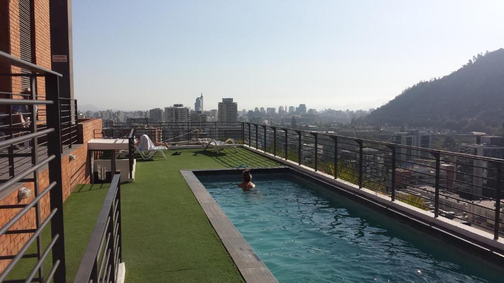 Vista de la piscina de Aucity Suites o alrededores