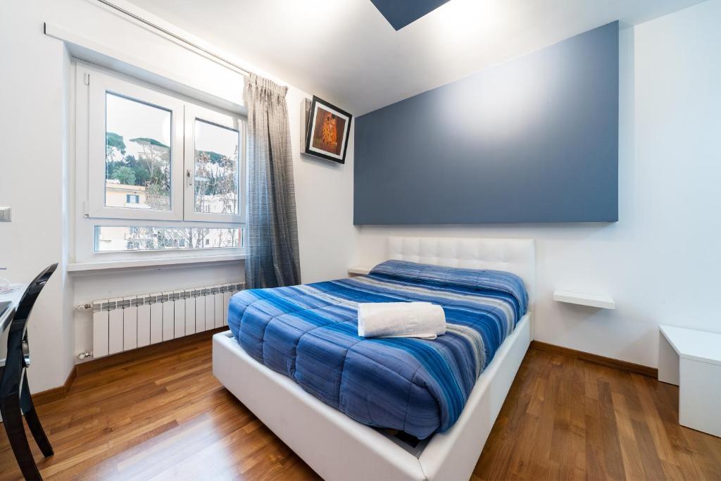 Letto o letti in una camera di Il Rosso e il Blu