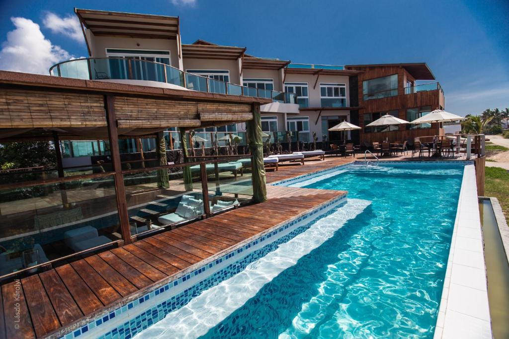 The swimming pool at or close to Iguana Crossing Boutique Hotel