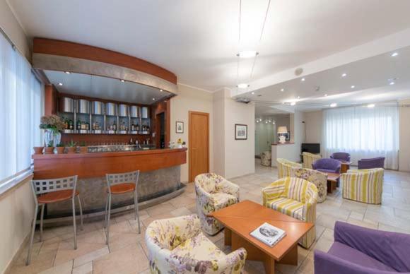 Lounge oder Bar in der Unterkunft Hotel Lux