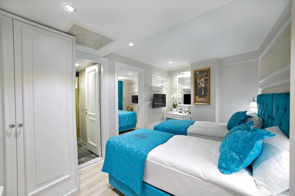 Кровать или кровати в номере Glamour Hotel Istanbul Sirkeci