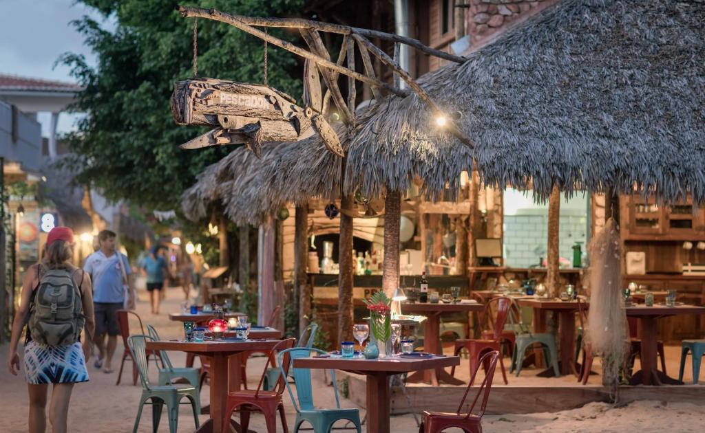A restaurant or other place to eat at Pescador - Pousada de Charme