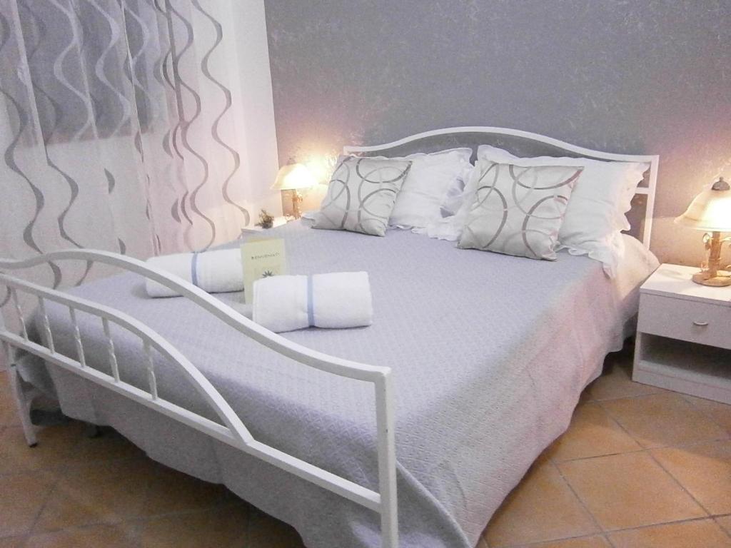 Postel nebo postele na pokoji v ubytování B&B La Rosa Lampedusa