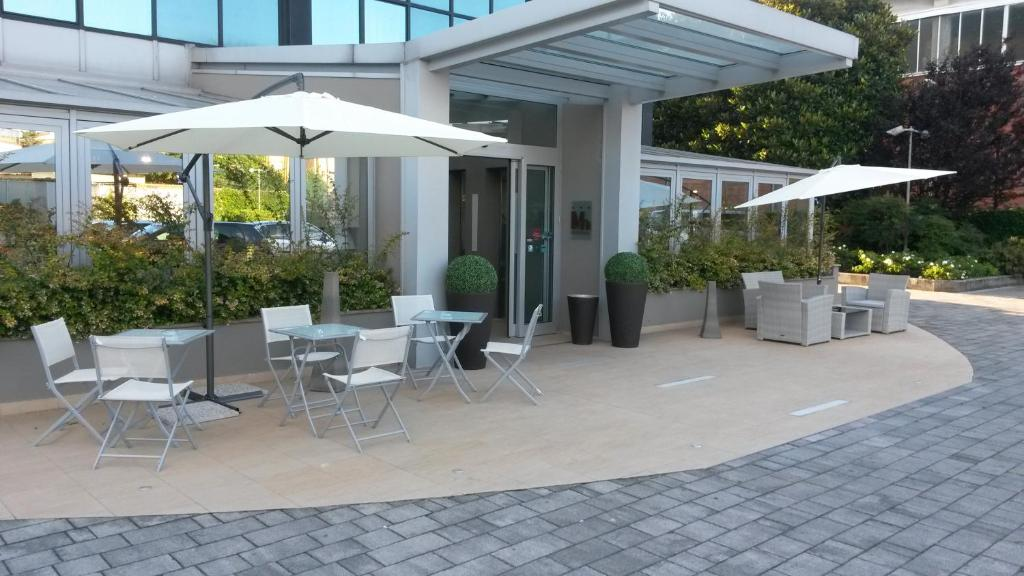 A porch or other outdoor area at Hotel Montini Linate Airport