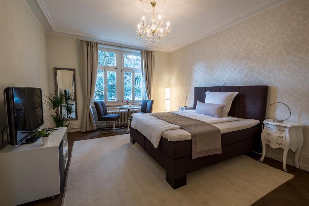 Ein Bett oder Betten in einem Zimmer der Unterkunft Beauvilla Bern