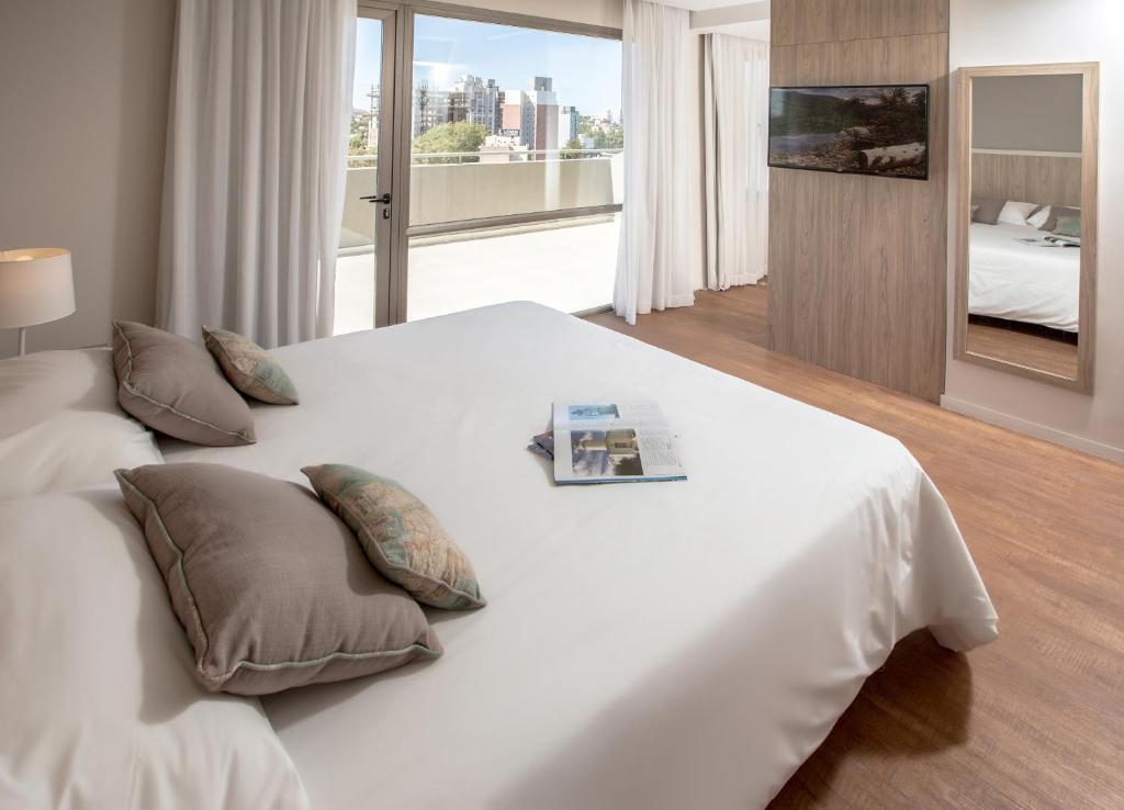 Una habitación de Hotel Comahue Business