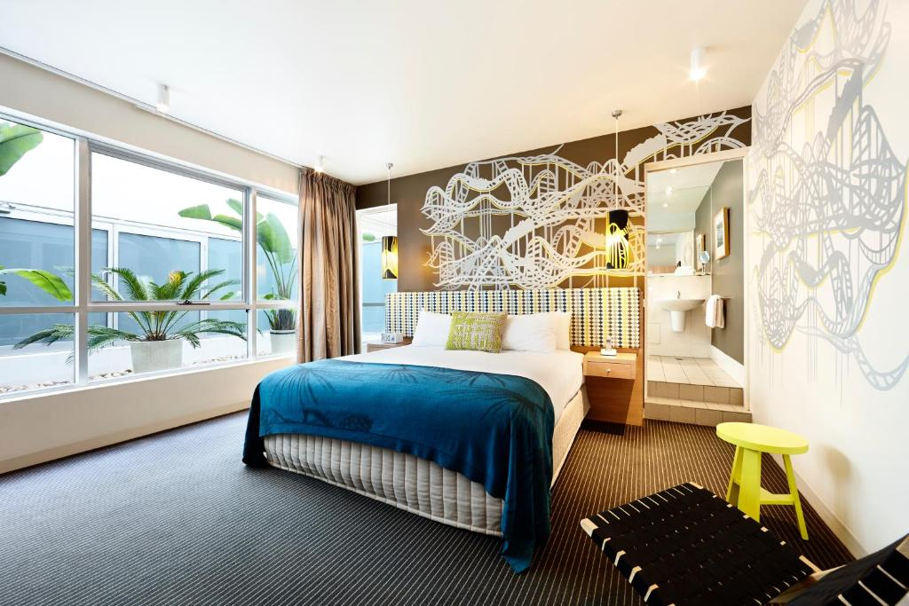 A bed or beds in a room at Rydges St Kilda
