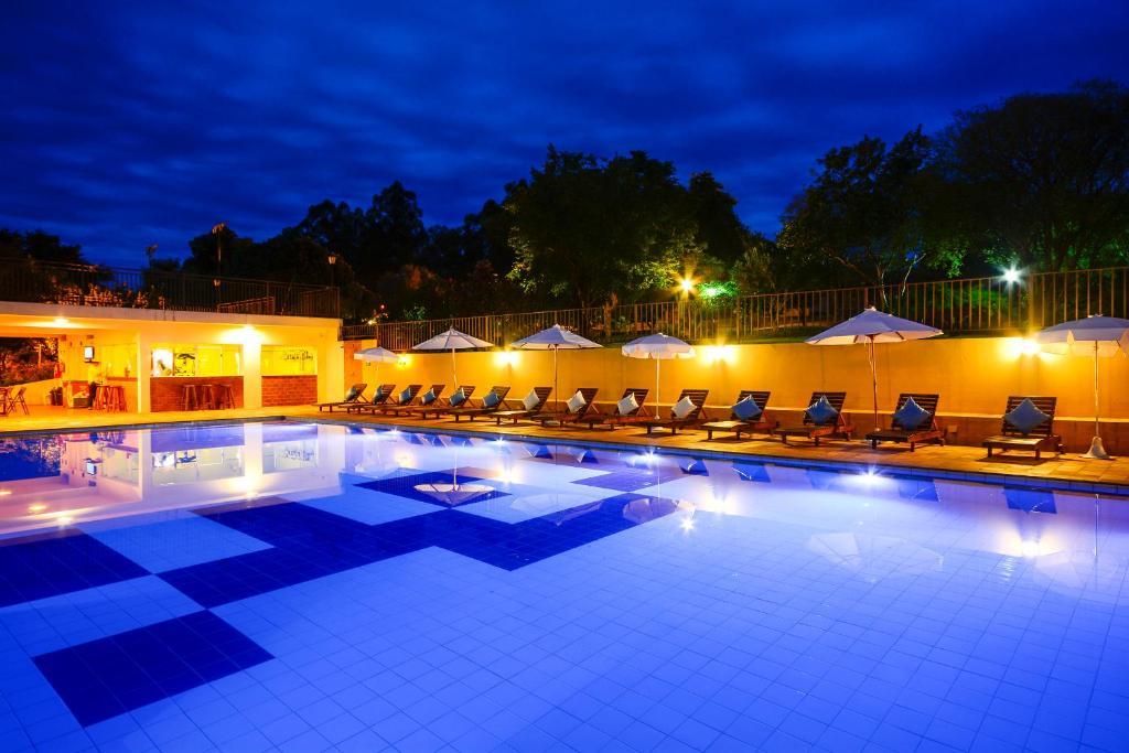 A piscina localizada em Hotel Fazenda Areia que Canta ou nos arredores