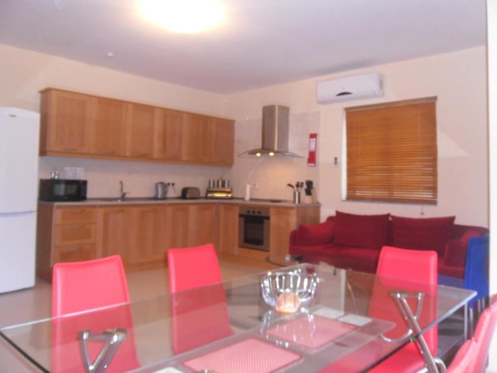 A kitchen or kitchenette at Mellieha Centre Apartments