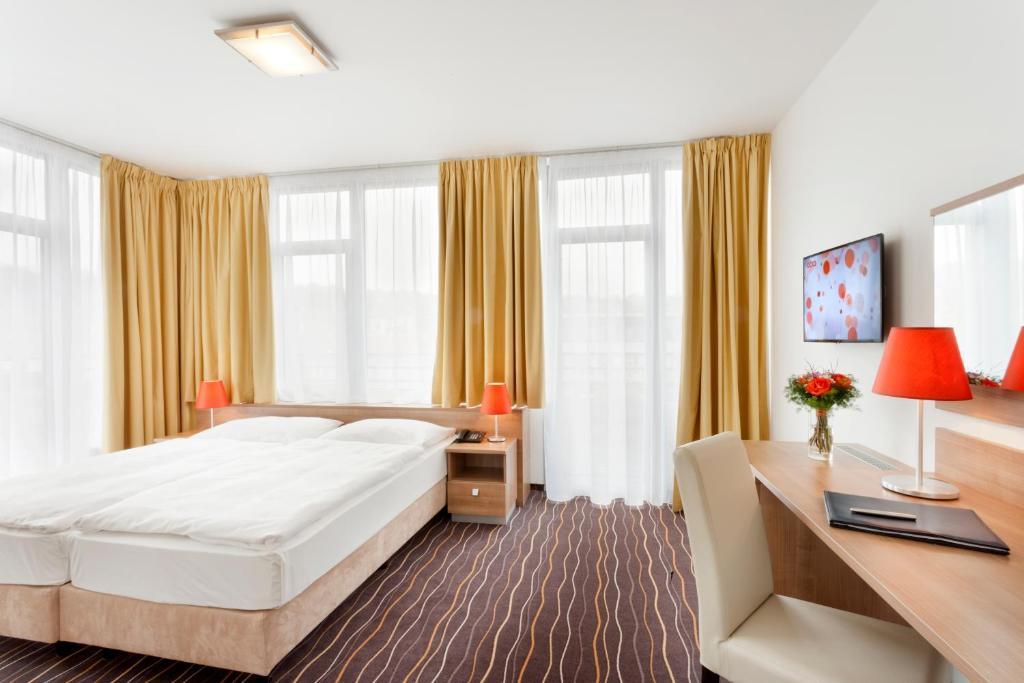 Кровать или кровати в номере Akcent hotel